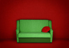 Creative interior with sofa. Creative red interior with green sofa Royalty Free Stock Photography