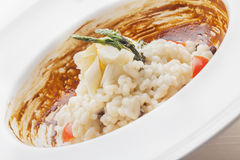 White Asparagus Risotto with licorice sauce Royalty Free Stock Images