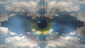 Creative 4k time laps video of moving clouds with reflection and mirror effect as in a kaleidoscope and multi-colored human eye