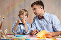 Creative kid learning origami Stock Photo