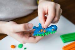 Child shapes of plasticine. creative kids royalty free stock image