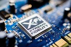 Creative Labs Sound Blaster Board With XFI Logo. Close up details of Creative Labs Sound Blaster board with soft focus background and shallow depth of field Royalty Free Stock Photos
