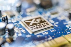 Creative Labs Sound Blaster Board With XFI Logo. Close up details of Creative Labs Sound Blaster board with soft focus background and shallow depth of field Stock Images