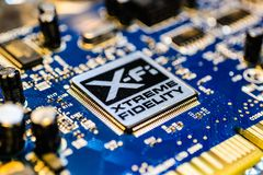 Creative Labs Sound Blaster Board With XFI Logo. Close up details of Creative Labs Sound Blaster board with soft focus background and shallow depth of field Royalty Free Stock Photo