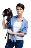 Creative lady-photographer takes snaps Royalty Free Stock Image