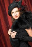 Creative lady. Portrait of young woman in creative image and in vintage hat Royalty Free Stock Image