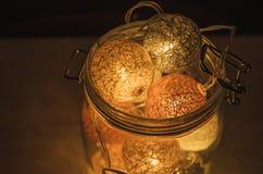 Creative Lamp made of cotton balls in glass jar Stock Photos