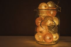 Creative Lamp made of cotton balls in glass jar with sign of hea Royalty Free Stock Photo