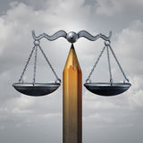Creative Law. Legal concept or education rights as a pencil balancing a justice scale as a metaphor for lawyer planning or free speech rights as a 3D stock illustration