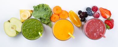 Creative layout of fresh smoothies. And ingredients, top view Stock Photos