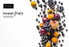 Creative  layout  of fresh summer fruits on a white background with space for text. Plum, blackberry, grapes, peach, apricot. View from above Stock Photography