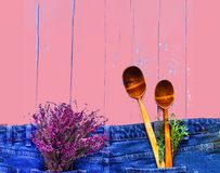 Creative layout. Heather color and wooden spoons on denim texture.n stock photo