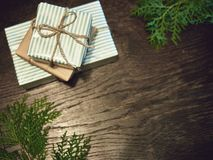 Creative layout made of Christmas tree branches with gifts. Flat stock photos