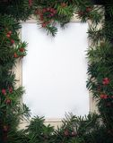 Creative layout made from Christmas tree branches with red berries and frame paper card note. Copy space for text. Flat lay. Creative layout made from Christmas stock photography