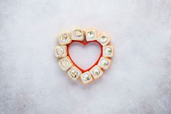 Creative layout made of heart shaped set of sushi rolls. stock images