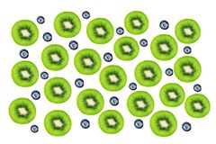 Creative layout made of Kiwi fruits and blueberry. Many slices o stock photography