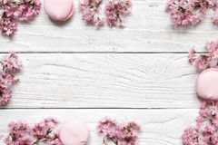 Creative layout made with pink cherry blossom flowers on white wooden background. Flat lay. top view. wedding frame. Spring minimal concept stock photo