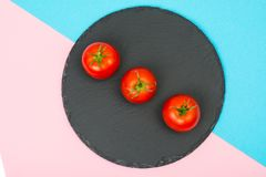 Creative layout made from red tomatoes on bright background. Studio Photon Royalty Free Stock Photography