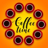 Creative layout of red coffee cups and a saucer on an orange bac Royalty Free Stock Photo