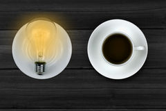 Creative light bulbs and coffee mix. Coffee brings a good mood Royalty Free Stock Photography