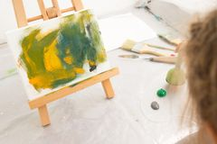 Creative little child painter in working process stock photo