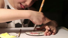 Creative little fella paints a coaster to make a decoupage product stock footage