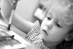 Creative little girl draws. Royalty Free Stock Photo