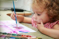 Creative little girl draws. Royalty Free Stock Photography