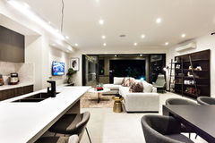Creative living room including kitchen, dinner, shelf and living Royalty Free Stock Image