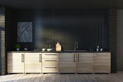 Creative loft black kitchen interior. Creative loft black kitchen studio inteior with furniture and decorative objects. Living, residential, design and lifestyle Royalty Free Stock Images