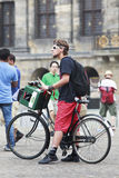 Creative looking young man in Amsterdam. AMSTERDAM-AUG. 19, 2012. Creative looking young man on Aug. 19 in Amsterdam. Many artists live and work in Amsterdam Stock Images