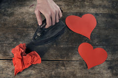 Creative love concept, ironing wrinkled hearts on a beautiful old table Royalty Free Stock Images
