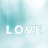 Creative love letters hang on cyan background Royalty Free Stock Photo