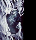 Creative make up like Ethiopian mask, white pattern on black fac. E close up, halloween horror royalty free stock photos