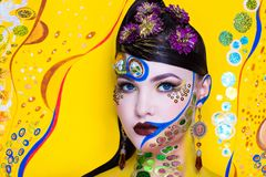 Hallucination make up. Creative make-up new conceptual idea. colorful bold faceart body art painting. Crazy new graphic abstract picture woman face surrealistic Royalty Free Stock Images