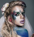 Creative make up with splashes of color. Body ert Stock Photo