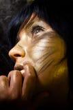 Creative make-up. Technique: golden paint stock image