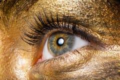 Creative make-up. Technique: golden paint, macro shot stock image