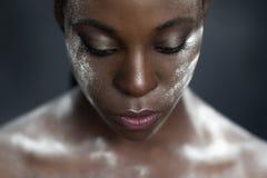 Creative makeup. black skin and white powder Stock Photo