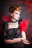 Creative makeup and blood image of the evil queen. Royalty Free Stock Photo