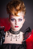 Creative makeup and blood image of the evil queen. Royalty Free Stock Images