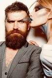 Creative makeup. Couple in love with creative makeup look. Sensual woman kiss bearded man with creative makeup and body stock photo