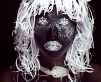 Creative makeup like Ethiopian mask, white pattern Stock Photos