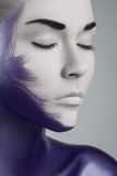 Creative makeup. Topic: girl with artistic make-up purple in the studio Stock Image