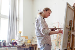 Creative male artist drawing picture oil paints Stock Photography