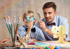 Creative male babysitter with child. Photo of creative male babysitter during play with child stock images