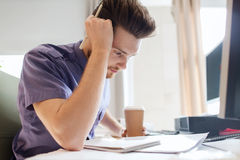 Creative male office worker with coffee thinking Royalty Free Stock Photography