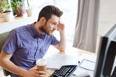 Creative male worker with computer drinking coffee Royalty Free Stock Photo