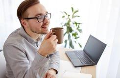 Creative man or businessman drinking coffee Stock Image