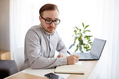 Creative man or businessman writing to notebook Stock Photos